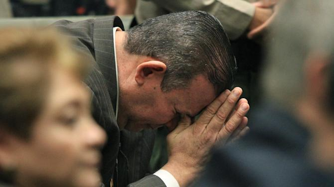 Luis Artiga reacts after being acquitted on all charges in the Bell corruption trial on Wednesday, March 20, 2013, in Los Angeles.  Five former elected officials were convicted of multiple counts of misappropriation of public funds.  Former Mayor Oscar Hernandez and co-defendants George Cole, Teresa Jacobo, George Mirabal,  and Victor Belo were all convicted of multiple counts and acquitted of others.  The charges against them involved paying themselves inflated salaries of up to $100,000 a year in the city of 36,000 people, where one in four residents live below the poverty line.   (AP Photo/Los Angeles Times, Irfan Khan, Pool)