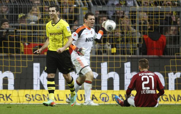 Borussia Dortmund's Mkhitaryan celebrates a goal against Nuremberg during their German first division Bundesliga soccer match in Dortmund