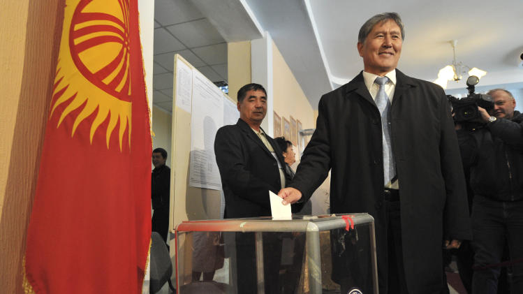 Front-runner Almazbek Atambayev casts his ballot at a polling station during the presidential election in Bishkek, Kyrgyzstan, Sunday, Oct. 30, 2011. Voters in the turbulent Central Asian nation of Kyrgyzstan headed to polling stations Sunday to cast their ballots in the presidential election that could set a democratic precedent for the region. (AP Photo/Vladimir Voronin)