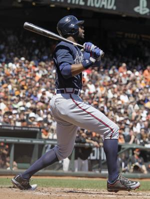 Atlanta Braves' Jason Heyward hits a three-run homer off San Francisco Giants starting pitcher Madison Bumgarner during the third inning of their baseball game in San Francisco, Saturday, Aug. 25, 2012. (AP Photo/Eric Risberg)