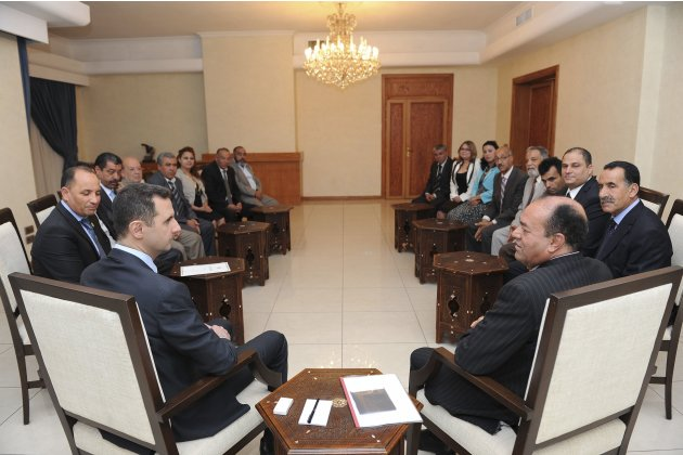 Syria's President al-Assad speaks with Suleiman Harmasi secretary general of Tunisian al-Thawabit Party, and head of Tunisian delegation, during a meeting in Damascus