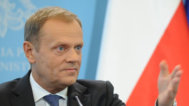 Polish Prime Minister Donald Tusk speaks during a press conference in Warsaw, Poland, Thursday, June 19, 2014. Tusk said early elections within weeks may be necessary if an expanding political crisis sparked by eavesdropping on political leaders is not contained. (AP Photo/Alik Keplicz)