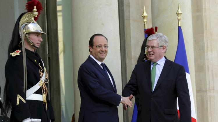 Ireland's Deputy PM Gilmore shakes hand with France's President Hollande at the Elysee Palace in Paris