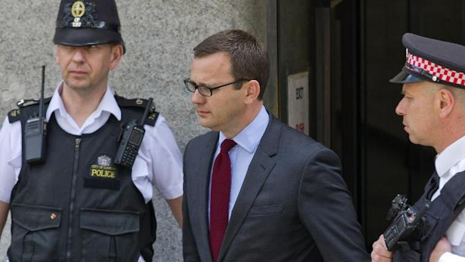 Former top aide to British Prime Minister David Cameron and former News of the World editor Andy Coulson leaves the Old Bailey in central London on June 25, 2014