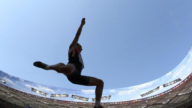 Schrader of Germany competes in the long jump event of the men's decathlon during the 15th IAAF World Championships at the National Stadium in Beijing