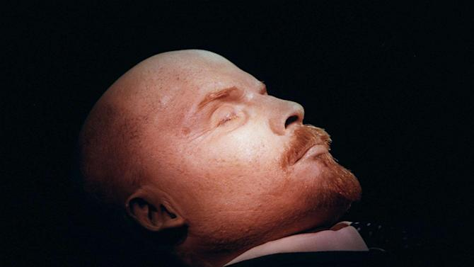 FILE - In this April 16, 1997 file photo, the embalmed body of Vladimir Lenin, founder of the Soviet Union, is on display in his tomb on Moscow's Red Square. Lenin is one of several world leaders whose bodies have been preserved and put on perpetual display, as Venezuela's government plans to do with Hugo Chavez. (AP Photo/Sergei Karpukhin, File)