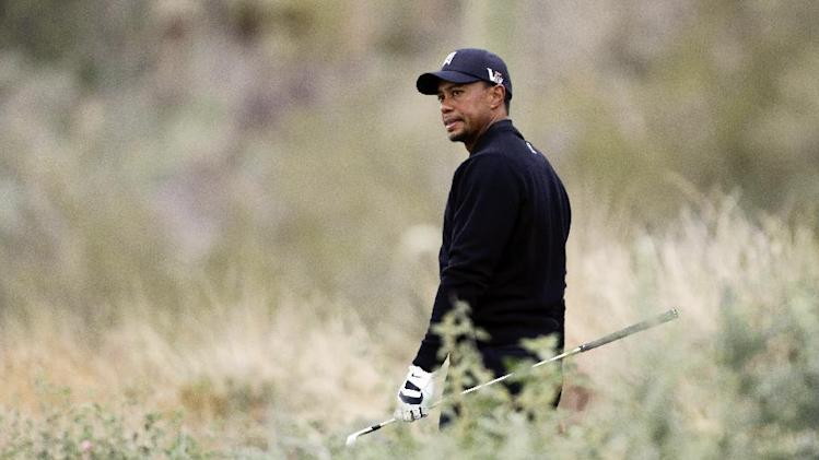 Tiger Woods looks down from the 12th tee box at his lie on the fairway in the first round against Charles Howell III during the Match Play Championship golf tournament, Thursday, Feb. 21, 2013, in Marana, Ariz. (AP Photo/Ted S. Warren)