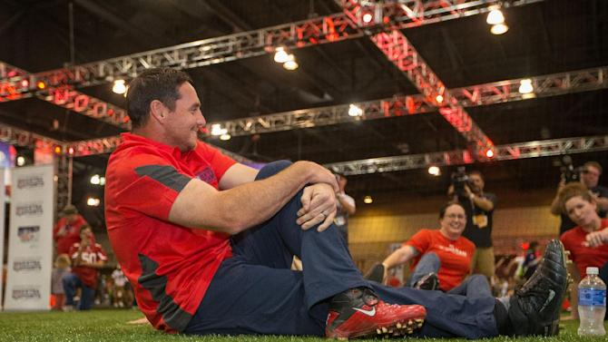 IMAGE DISTRIBUTED FOR BARCLAYCARD - Chicago Bears kicker Jay Feely stretches with the Pat Tillman Foundation Scholars at the NFL Extra Points Card Charity Kick, Wednesday, Jan. 28, 2015 in Phoenix. (AP Photo/Jeff Lewis for Barclaycard)