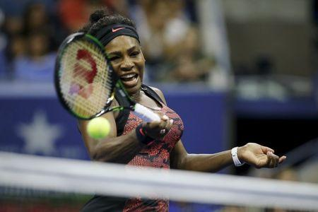 Williams of the U.S. returns a shot to Mattek-Sands of the U.S. during their match at the U.S. Open Championships tennis tournament in New York