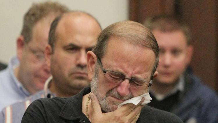 Jack Kern reacts after a jury reached a guilty verdict on all accounts in the Brogan Rafferty Craigslist murder trial in the courtroom of Judge Lynn S. Callahan in the Summit County Courthouse on Tuesday, Oct. 30, 2012 in Akron, Ohio. Kern's son Timothy of Massillon was one of the men murdered. Rafferty, an Ohio teenager taken under the wing of a man defense attorneys described as a master manipulator was found guilty of aggravated murder Tuesday for his role in a deadly plot to lure men desperate for work with phony Craigslist job offers. (AP Photo/Akron Beacon Journal, Phil Masturzo, Pool)
