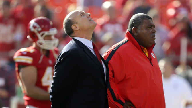 Kansas City Chiefs general manager Scott Pioli, left, and coach Romeo Crennel stand together before an NFL football game against the Carolina Panthers at Arrowhead Stadium in Kansas City, Mo., Sunday, Dec. 2, 2012. On Saturday, Kansas City Chiefs linebacker Jovan Belcher thanked Pioli and Belcher for giving him a chance in the NFL, before he turned away and fatally shot himself. (AP Photo/Ed Zurga)