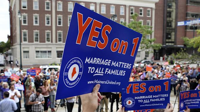 FILE - In this Sept. 10, 2012, file photo, gay marriage supporters gather at a rally outside of City Hall in Portland, Maine, in support of an upcoming ballot question that seeks to legalize same-sex marriage. After all the economy-focused campaign talk, voters in some states will get a chance on Election Day to sound off on intriguing topics that the presidential rivals ignored, including gay marriage, death-penalty repeal, marijuana legalization and assisted suicide. (AP Photo/Joel Page, File)