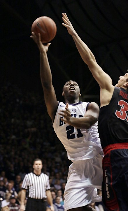 Butler forward Roosevelt Jones shoots over Gonzaga guard Mike Hart during the first half of an NCAA college basketball game Saturday, Jan. 19, 2013, in Indianapolis. (AP Photo/AJ Mast)