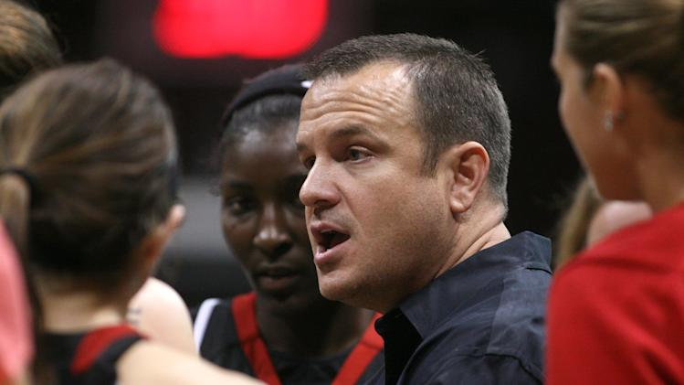 Louisville head coach Jeff Walz talks to his team during a timeout during the second half of an NCAA college basketball game, Sunday, Nov. 13, 2011, in Springfield, Mo. Louisville defeated Missouri State 73-64. (AP Photo/Mark Schiefelbein)