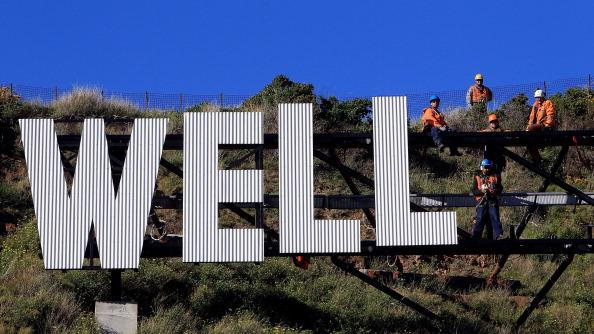 Workers install Wellington Airport's 'Wellington Blown Away' sign on July 27, 2012 in Wellington, New Zealand. The city was originally planning to put up a 'Wellywood' sign in 2010 to promote the local film industry but due to a public backlash decided to erect the sign designed by Matt Sellars and Raymond McKay. (Photo by Hagen Hopkins/Getty Images)