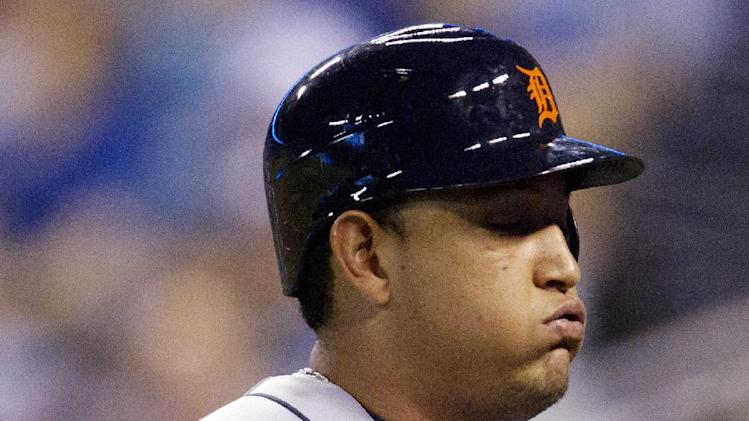 Detroit Tigers' Miguel Cabrera (24) returns to the dugout after striking out in the fourth inning of a baseball game against the Kansas City Royals at Kauffman Stadium in Kansas City, Mo., Wednesday, Oct. 3, 2012. (AP Photo/Orlin Wagner)
