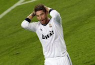 Real Madrid&#39;s defender Sergio Ramos reacts during the Spanish League Clasico football match FC Barcelona vs Real Madrid CF at the Camp Nou stadium in Barcelona