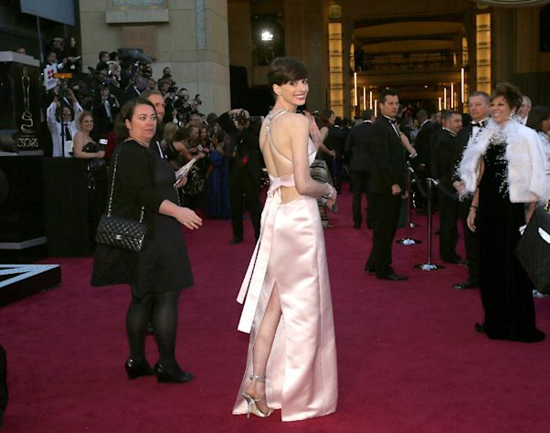 Actress Anne Hathaway arrives at the Oscars at the Dolby Theatre on Sunday Feb. 24, 2013, in Los Angeles. (Photo by Carlo Allegri/Invision/AP)