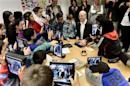 Fifth graders use their iPads to take photos of Sweden's PM Reinfeldt during his visit to Husby School, west of Stockholm