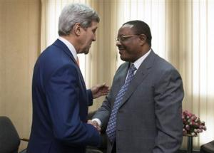 Ethiopian PM Desalegn shakes hands with U.S. Secretary of State Kerry before meetings held at the United Nations Economic Commission for Africa (UNECA) in Addis Ababa