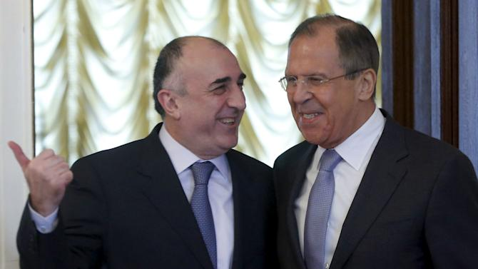 Russian Foreign Minister Lavrov and his Azerbaijani counterpart Mammadyarov enter hall during their meeting in Moscow