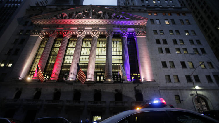 A police car patrols in front of the New York Stock Exchange, Wednesday, Oct. 31, 2012 before it reopens for trading for the first time this week following a two-day shutdown due to superstorm Sandy. Stock futures are rising ahead of the opening bell. Much of lower Manhattan and the financial district are still without electrical power. (AP Photo/Mark Lennihan)