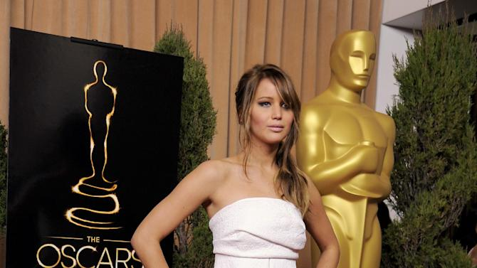 "Jennifer Lawrence, nominated for best actress in a leading role for ""Silver Linings Playbook,"" arrives at the 85th Academy Awards Nominees Luncheon at the Beverly Hilton Hotel on Monday, Feb. 4, 2013, in Beverly Hills, Calif. (Photo by Chris Pizzello/Invision/AP)"