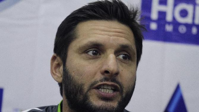 Pakistan's Twenty20 captain Shahid Afridi speaks to reporters at the Gaddafi stadium in Lahore, Pakistan, Thursday, May 21, 2015. With security measures so far holding up, international cricket returns to Pakistan on Friday for the first time in six years when it hosts Zimbabwe in a Twenty20 match. (AP Photo/K.M. Chaudary)