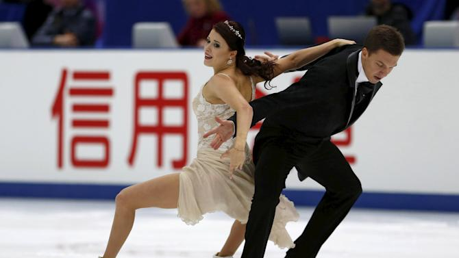 Ekaterina Bobrova and Dmitri Soloviev of Russia perform during the ice dance short dance program at the ISU Grand Prix of Figure Skating in Nagano