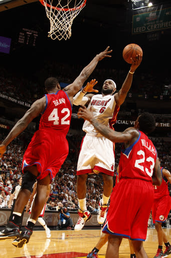 James gets season-high 41, Heat beat 76ers 99-93