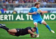Italy's winger Mirco Bergamasco (R) is tackled by New Zealand All Blacks winger Hosea Gear during their International Rugby Union match at the Olympic Stadium in Rome. The All Blacks won 42-10