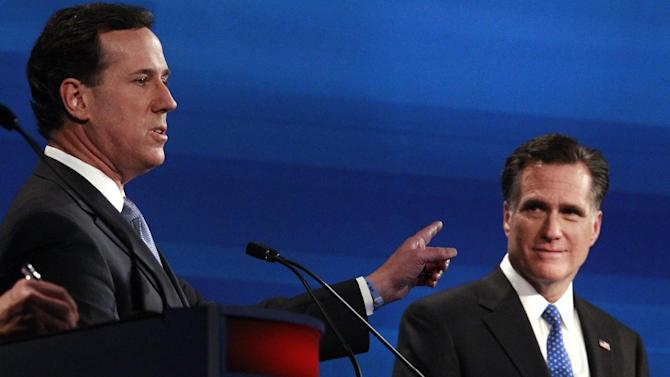 """FILE - In this Jan. 16, 2012 file photo Republican presidential candidates former Pennsylvania Sen. Rick Santorum counters former Massachusetts Gov. Mitt Romney, right, during the South Carolina Republican presidential debate in Myrtle Beach, S.C. Remember Newt Gingrich calling Romney a liar? Michele Bachmann saying Romney's unelectable? Santorum calling Romney """"the worst Republican in the country"""" to run against Obama? They're hoping you don't. And acting like it never happened _ even though most of their words are just clicks away online. (AP Photo/Charles Dharapak, File)"""