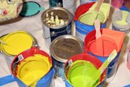 "Cans of paint. Thailand's Culture Ministry on Monday demanded an explanation from the producer of a talent show which broadcast a female contestant painting with her bare breasts on national television. The contestant on the Sunday show of ""Thailand's Got Talent"" poured tins of coloured paint on herself then rubbed against canvas as the judges watched open-mouthed and the audience cheered"