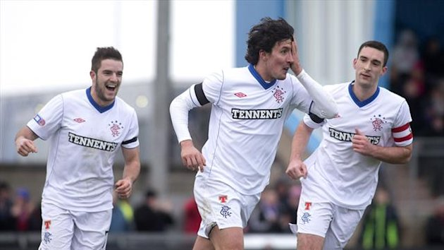 Fran Sandaza, centre, was on target as Rangers beat Peterhead