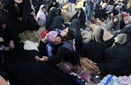 Iranians mourn for their loved ones in the village Baje-Baj, near the town of Varzaqan. Iran on Sunday stepped up relief operations in shattered villages in its northeast after saying rescue operations were completed following a double earthquake which cost 227 lives and injured 1,380 people