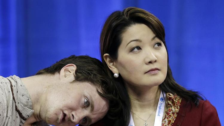 Jeremy Abbott reacts with his coach Yuka Sato after competing in the senior men's free skate program at the U.S. figure skating championships, Sunday, Jan. 27, 2013, in Omaha, Neb. (AP Photo/Charlie Neibergall)