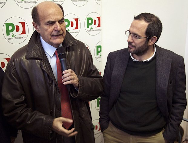 In this Jan. 19, 2013 photo Pier Luigi Bersani and Umberto Ambrosoli meet in Milan, Italy. Lombardy, Italy&#39;s most populous and economically productive region, is a key battleground in the upcoming national elections, with the regional race not only likely to determine who can most reliably govern the euro zone&#39;s third-largest economy but also testing emerging political alliances. Polls show that the center-right coalition led by Silvio Berlusconi and the center-left forces backing Democratic Party leader Pier Luigi Bersani&#39;s bid for premier are neck-and-neck in Lombardy, geographically centered around the financial and fashion capital Milan, marking the first time in the Berlusconi era that the left has had such a strong showing in region where the media mogul made his mark. (AP Photo/Alessandro Treves, Lapresse) ITALY OUT