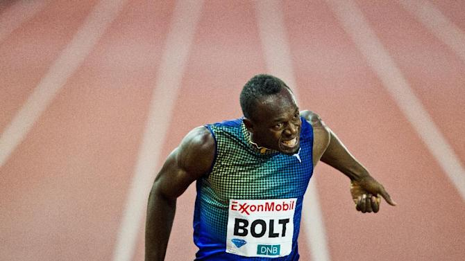 Usain Bolt of Jamaica wins the men's 200 metres during the Diamond League athletics competition at the Bislett Stadium in Oslo, Thursday June 13, 2013. (AP Photo/NTB Scanpix, Vegard Grott)  NORWAY OUT