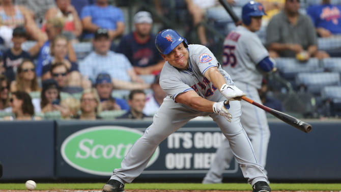 New York Mets' Bartolo Colon strikes out in the fifth inning of a baseball game against the Atlanta Braves, Sunday, June 26, 2016, in Atlanta. (AP Photo/John Bazemore)