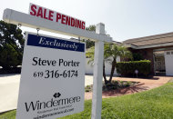 FILE - This Wednesday, Aug. 14, 2013, photo, shows a home with a sale pendingin San Diego. The National Association of Realtors reports on the number of Americans who signed contracts to buy homes in August on Thursday, Sept. 26, 2013. AP Photo/Gregory Bull, File)