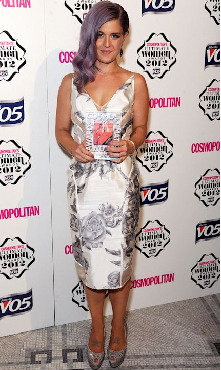 Kelly Osbourne deserved her Ultimate Style Icon Awards -  showing off her newly svelte figure in a knee-length floral frock. Copyright [Getty]