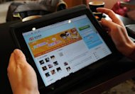 "A woman views the Chinese social media website Weibo at a cafe in Beijing. China has closed 42 websites and deleted more than 210,000 posts since mid-March in a crackdown on online ""rumours"" as a major political scandal rocked the country"