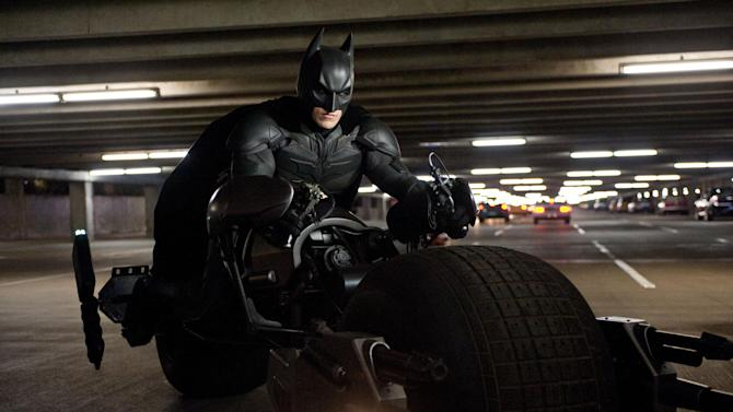 "This undated film image released by Warner Bros. Pictures shows Christian Bale as Batman in a scene from the action thriller ""The Dark Knight Rises."" A gunman in a gas mask barged into a crowded Denver-area theater during a midnight premiere of the Batman movie on Friday, July 20, 2012, hurled a gas canister and then opened fire, killing 12 people and injuring at least 50 others in one of the deadliest mass shootings in recent U.S. history. (AP Photo/Warner Bros. Pictures, Ron Phillips)"