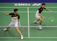 Cai Yun (R) and Fu Haifeng (L) of China, pictured in action during the Hong Kong Open badminton tournament, on November 25, 2012. China look set to confirm their dominance of world badminton when the Sudirman Cup gets under way on Sunday as their rivals try to find a way to prevent a ninth Chinese team championship in the event
