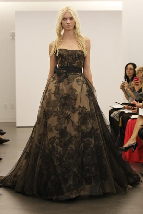 Ease your way into the black dress trend with a black lace overlay. This would be beautiful for a fall or winter ceremony.