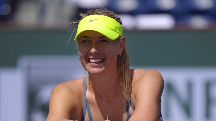 Maria Sharapova, of Russia, poses with the trophy after defeating Caroline Wozniacki, of Denmark, 6-2, 6-2 in their match at the BNP Paribas Open tennis tournament, Sunday, March 17, 2013, in Indian Wells, Calif. (AP Photo/Mark J. Terrill)