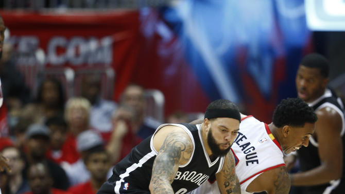 Brooklyn Nets guard Deron Williams, front, has the ball knocked away by Atlanta Hawks guard Jeff Teague (0) in the first half of an NBA playoff basketball game  Sunday, April 19, 2015, in Atlanta.  (AP Photo/John Bazemore)