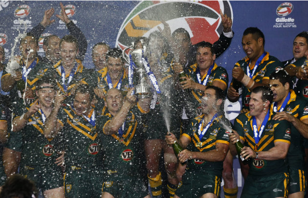Australian captain Darren Lockyer celebrates with teammates after defeating England in the four nations rugby league final at Elland Road, Leeds, England, Saturday Nov. 19, 2011. (AP Photo/Tim Hales)