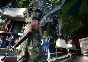 Thai soldier walks in front of the National Broadcasting…