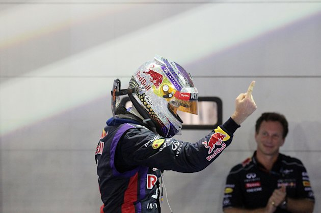 Red Bull driver Sebastian Vettel, left, of Germany celebrates while his team principal Christian Horner, right, looks on, after winning the Singapore Formula One Grand Prix on the Marina Bay City Circuit in Singapore, Sunday, Sept. 22, 2013.(AP Photo/Wong Maye-E)